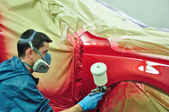 Worker painting a car — Stock Photo