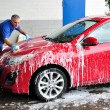Man washing a car - Stock Photo