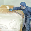 Worker painting car. — Stock Photo
