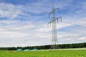Bio fuel plant and power line. — Stock Photo