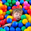 Boy playing with balls. — Stock Photo
