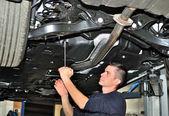 Mechanic under car. — Stock Photo