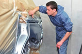 Proffesional car paint worker. — Stock Photo