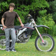 Teenager with dirt bike — Stock Photo