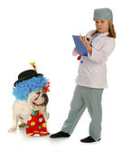 Child vet and silly dog — Stock Photo