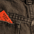 Ticket in back pocket of pair of pants or jeans - Stock Photo