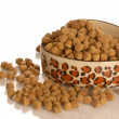 Stock Photo: Bowl of dog kibble in heart shaped dog dish isolated