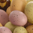 Pastel easter eggs in a wicker baske — Stock Photo #24072469