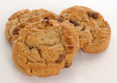 Three peanut butter chocolate chunk cookies — Stock Photo