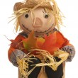 Autumn basket with halloween scarecrow - Stock Photo