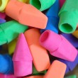 Bright colored pencil eraser tops stacked up - Stock Photo