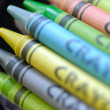 Childrens colorful wax crayons on black background — Stock Photo #24279227
