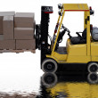 Industrial forklift loaded with boxes with water puddle reflection — Stock Photo