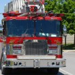 Stock Photo: Ladder firetruck on side of city street