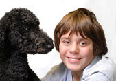 Tender moment shared between happy twelve year old boy and his dog — Stock Photo