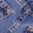 Details from the back pocket of demin jeans - Stock Photo