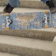 Stock Photo: Skateboard trick off stair set with intentional blur for motion