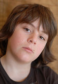 Bored young 12 year old with unhappy expression — Stock Photo