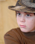 Twelve year old boy wearing hip plaid hat — Stock Photo