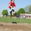 Public school level long jump at track and field day — Stock Photo