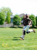 Openbare school niveau 100 meter dash op track & field evenement — Stockfoto
