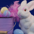 Easter bunny with easter eggs on blue background — Stock Photo #24365513