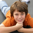 Happy good looking pre teen boy enjoying life — Stock Photo