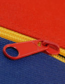 Details of zipper on blue and red canvas bag — Stock Photo