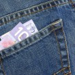 Canadian ten dollar bill in back pocket of blue jeans — Stock Photo #24374741