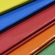 Bright colorful hanging file folders - Stock Photo