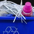 A blue recycling bin full of recyclable things — Stock Photo