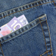 Canadese tien dollar bill in de rug zak van blue jeans — Stockfoto #24374741