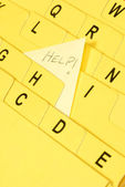 Alphabet index cards with help note coming out from the letter h — Stock Photo