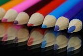 Several colorful pencil crayon with a reflection — Stock Photo