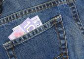 Canadian ten dollar bill in back pocket of blue jeans — Stock Photo