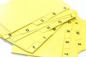 Yellow alphabet file cards for office use — Stock Photo