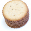 Stack of round crackers on white background - Stok fotoğraf