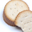 Stack of crackers with one with a bite out - Foto Stock