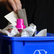 Hand putting recycling in bin with plastic and paper — Stock Photo #24416235