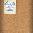 Stock Photo: Reduce reuse recycle on note tacked to corkboard