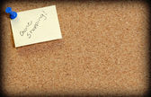 Cork board with note posted saying gone shopping — Stock Photo
