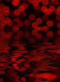 Círculos vermelhos de luz em fundo preto - bokeh — Fotografia Stock