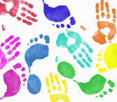 Multi colored finger painted hand and footprint pattern — Stock Photo