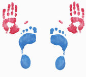 Two red hands and two blue feet fingerpainted — Stock Photo