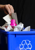 Hand putting recycling in bin with plastic and paper — Stock Photo