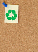Corkboard with recycle symbol on thumb tacked not — Stock Photo