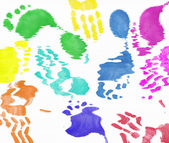 Multi colored expressive hand and foot prints background — Stock Photo