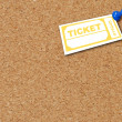 Yellow ticket thumb tacked to corkboard - room for copyspace — Stock Photo #24737653