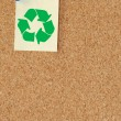 Corkboard with recycle symbol on thumb tacked not - Stock Photo