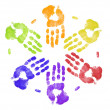 Bright colored hand prints working together - Stock Photo